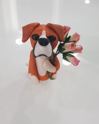 A boxer figure holding a bunch of flowers. Front facing