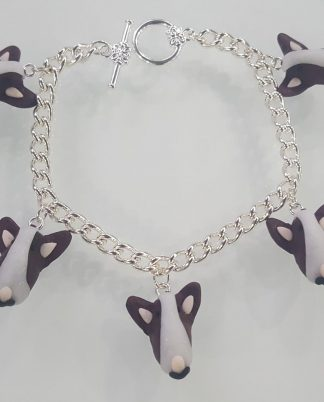 A bracelet with multiple english bull terrier face charms attached