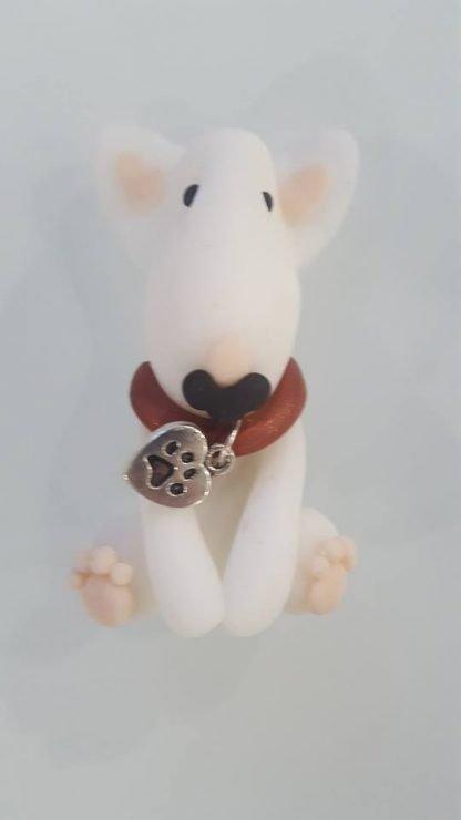 A fridge magnet of a full body white english bull terrier