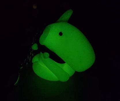 A keyring attached to a glow in the dark figure of an english bull terrier