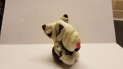 An english bull terrier figure with glow in the dark bandages under normal light wrapped in the style of a mummy