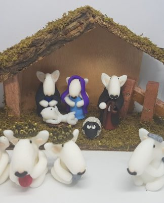 A nativity set made of white english bull terrier alternative characters