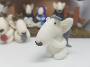 An english bull terrier figure in the style of an angel for the nativity set