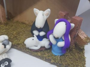 English bull terrier figure in the style of Mary, Joseph and baby Jesus for the nativity set