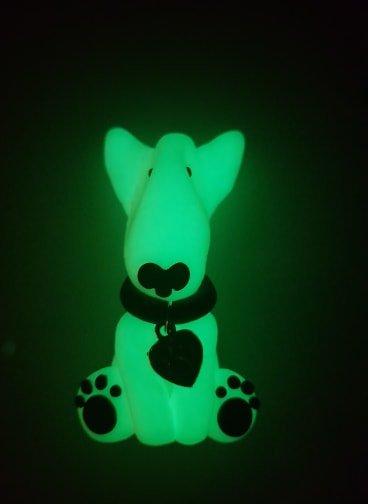 A glow in the dark fridge magnet of an english bull terrier full body