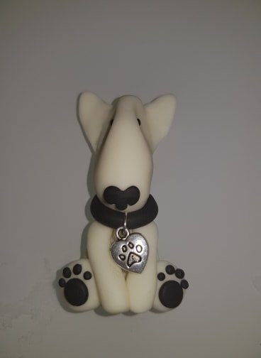 A glow in the dark fridge magnet in normal light of an english bull terrier full body